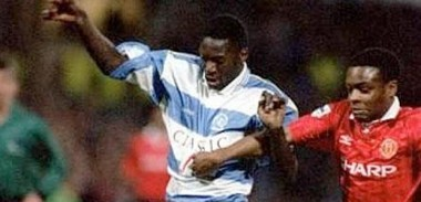 Dennis Bailey in action for QPR against Man United