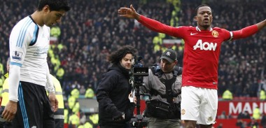 Patrice Evra celebrates the win against Liverpool