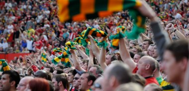 Manchester United fans waves their Green and Gold Scarves
