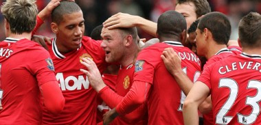 Manchester United players celebrate together